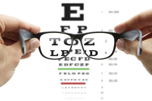 Looking through the glasses at eye chart